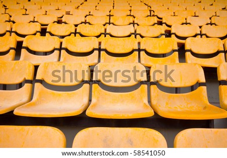 yellow seats in big stadium - stock photo