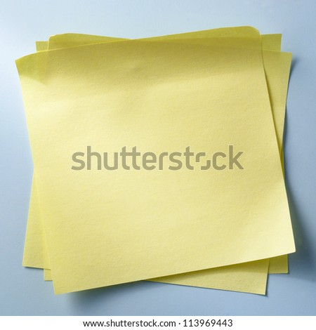 yellow sheet of paper for notes - stock photo