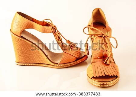 yellow shoes, sandals, isolated on a white background - stock photo