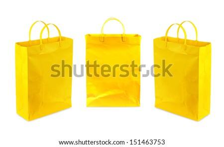 yellow shopping bag isolated on white background - stock photo