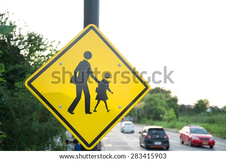 Yellow Sign close to school wait for kid cross the road  - stock photo