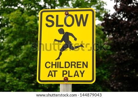 Yellow Slow Children at Play Road Sign - stock photo