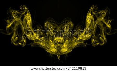 Yellow smoke abstract on black background - stock photo
