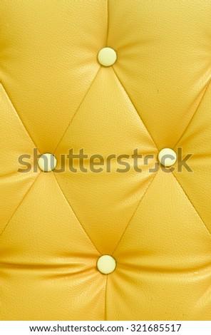 Yellow sofa background - stock photo