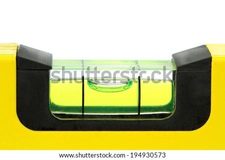 Yellow spirit level , macro image, on white background. - stock photo