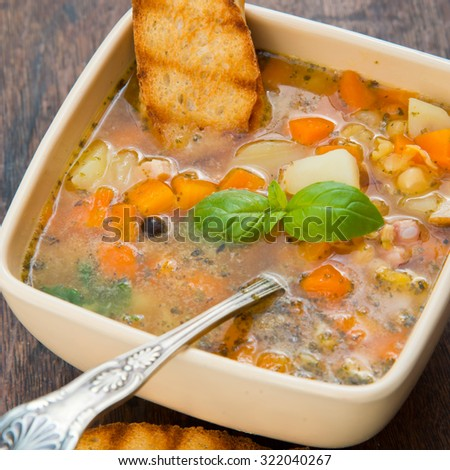 Yellow split pea soup with croutons - stock photo