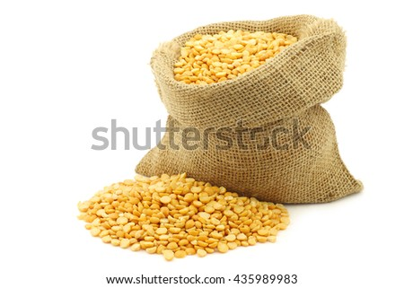 yellow split peas in a burlap bag on a white background - stock photo