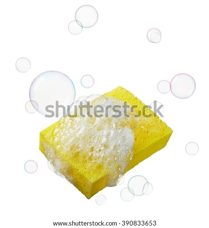 yellow sponge with lots of soaps and bubbles - stock photo