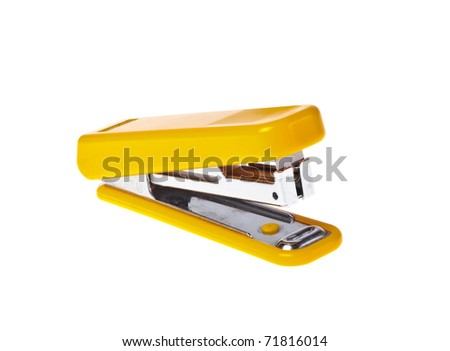 Yellow  stapler on a white background close-up (isolated). - stock photo