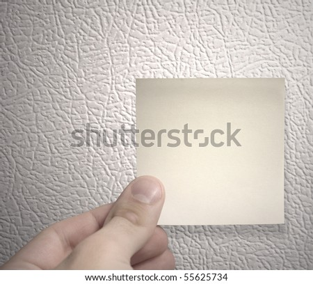 yellow sticky note on a fridge - stock photo