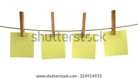 Yellow sticky notes with wood clothespin, isolated on white background - stock photo