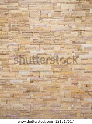 yellow stone wall - stock photo