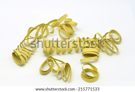 yellow streamers cotillion isolated in white background - stock photo