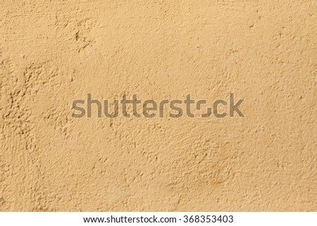 Yellow stucco wall. Background texture. - stock photo