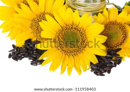 Yellow sunflowers and a handful of sunflower seeds isolated - stock photo