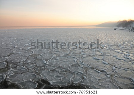 yellow Sunset on the sea - ice - floe. Poland, Gdynia - stock photo