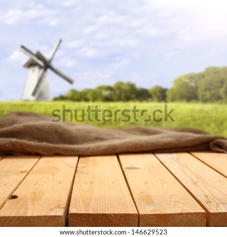 yellow table and white mill  - stock photo