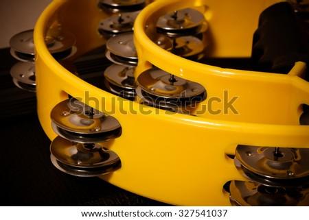 yellow tambourine background. - stock photo