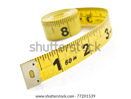 Yellow tape measure on rolled up on white background - stock photo