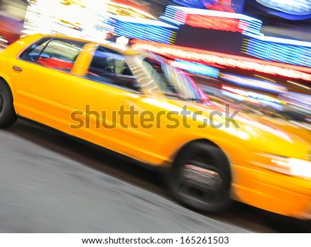 Yellow taxi speeding near Times Square in New York. - stock photo