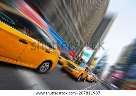 Yellow taxis in the streets of Manhattan, New York, USA - stock photo