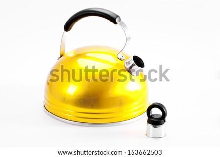 Yellow tea kettle isolated on white background - stock photo