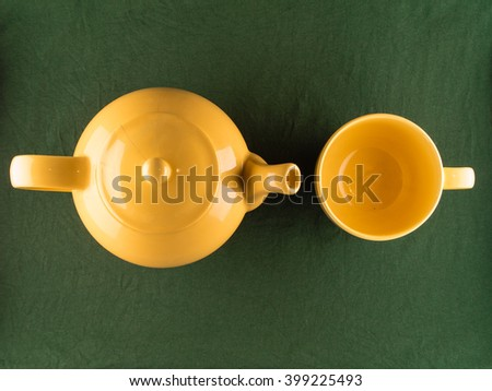 Yellow teapot and empty mug, copy space, top view - stock photo