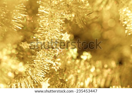 Yellow tinsel Christmas decoration - close-up photo - stock photo
