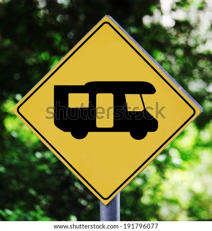 Yellow traffic label with camping bus pictogram - stock photo