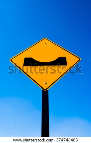 Yellow traffic sign on blue sky background - stock photo