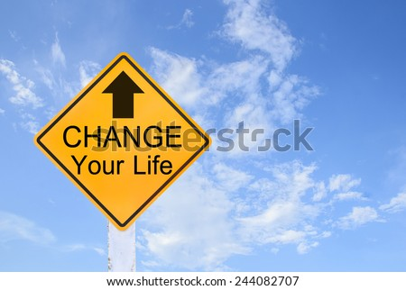 Yellow traffic sign text for change your life on blue sky background - stock photo