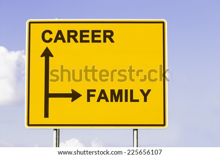 yellow traffic sign with arrows in two directions. One arrow shows the way to career, the other the way to family, concept for deciding between business job and private life - stock photo