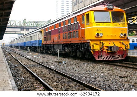 Yellow train engine and rail track - stock photo