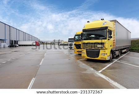 Yellow truck in warehouse - stock photo