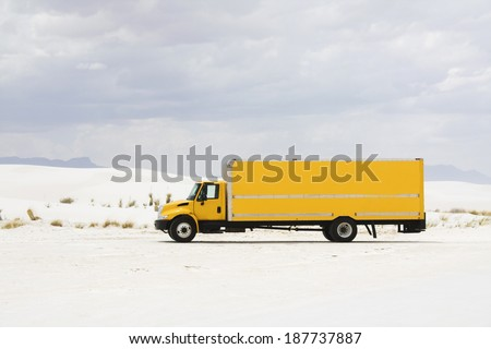Yellow truck in White Sand Dunes NM - New Mexico. - stock photo