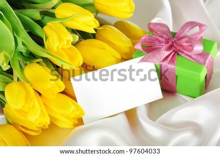 yellow tulips on silk - stock photo