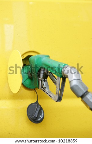 Yellow van being fueled with diesel - stock photo