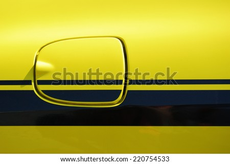 Yellow vehicle fuel filler cap closeup detail - stock photo