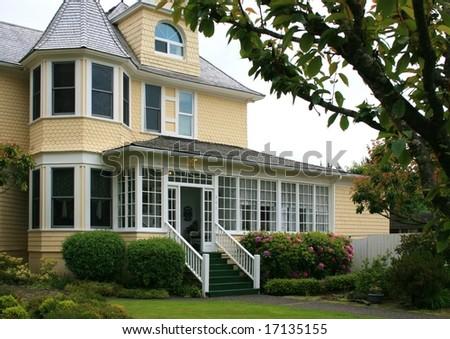 Yellow Victorian House - stock photo