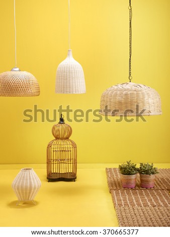 yellow wall interior decoration wicker lighting and wicker rug with yellow floor concept - stock photo