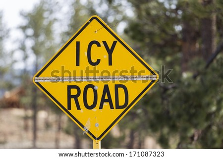 Yellow warning sign, Icy Road, United States - stock photo