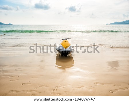Yellow water scooter on the beach - stock photo