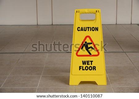 Yellow Wet Floor Sign - stock photo