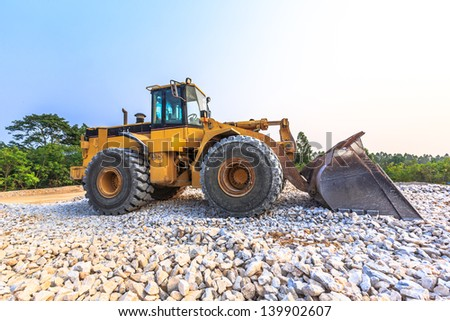 yellow wheel loader at mine site - stock photo