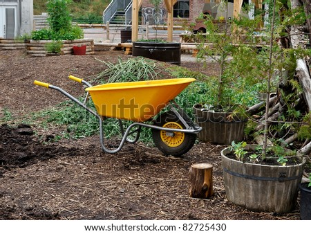 Yellow wheelbarrow at ecology center - stock photo