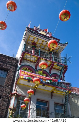 yellow, white and red building in Chinatown, San Francisco, California - stock photo