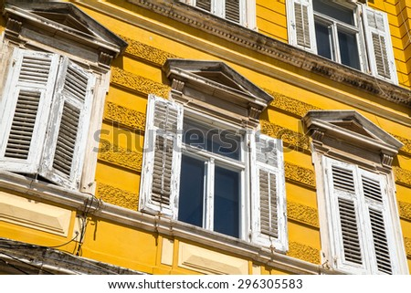 Yellow windows in itally buildings - stock photo
