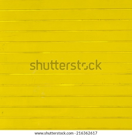 yellow wooden background of beach huts in Miami - stock photo