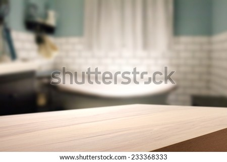 yellow wooden desk and interior of bathroom  - stock photo
