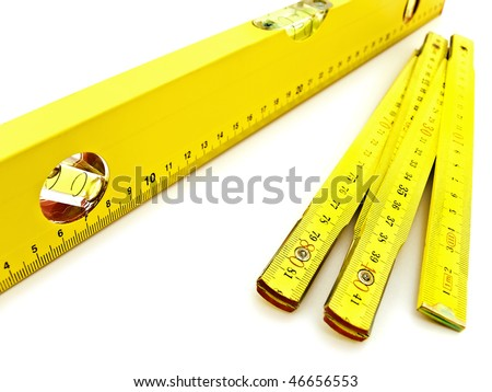 yellow wooden meter and level over the white background - stock photo